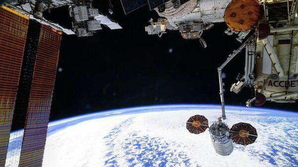 Одвајање теретног свемирског брода Цигнус од Међународне свемирске станице - Sputnik Србија