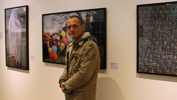 Fotograf agencije RIA Novosti Ilja Pitaljev na dodeli nagrade Sony World Photography Awards u Londonu - Sputnik Srbija