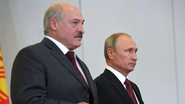 Председници Белорусије и Русије, Александар Лукашенко и Владимир Путин - Sputnik Србија
