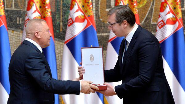 Одликовање поводом Дана државности уручено руском вајару Александру Рукавишњикову - Sputnik Србија