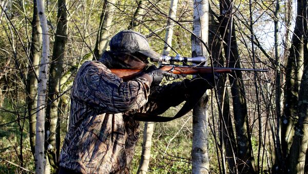 Ловац са пушком - Sputnik Србија