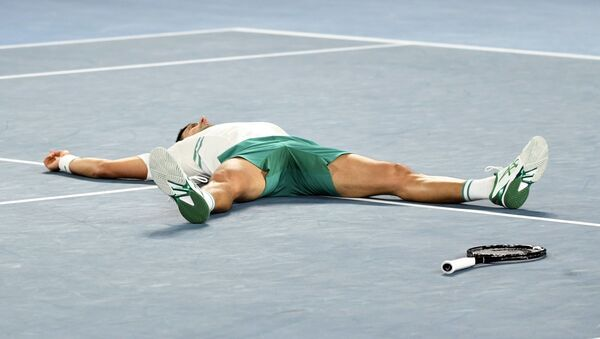 Novak Đoković po osvajanju titule na Australijan openu 2021. - Sputnik Srbija