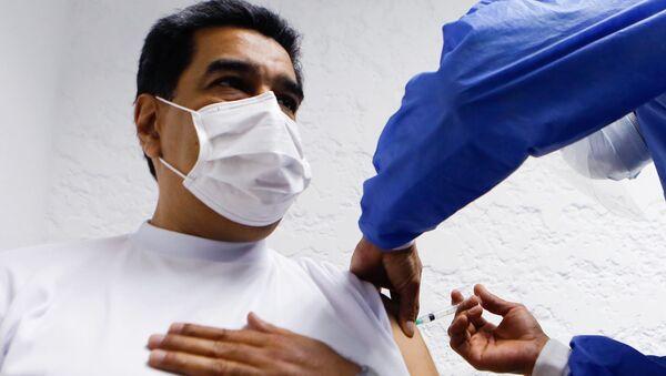 Nikolas Maduro prima rusku vakcinu  - Sputnik Srbija
