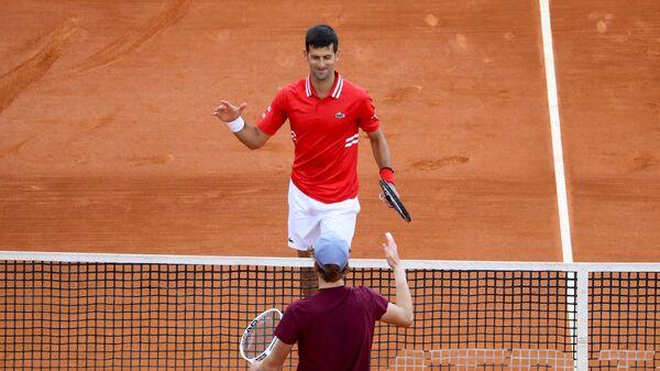 Novak Đoković i Janik Siner - Sputnik Srbija
