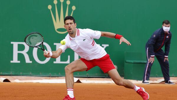 Novak Đoković tokom meča protiv Danijela Evansa u Monte Karlu - Sputnik Srbija