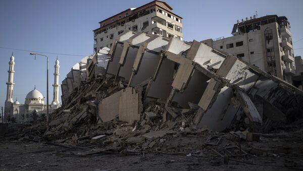 Сукоб Израела и Палестинаца, срушена зграда у појасу Газе - Sputnik Србија