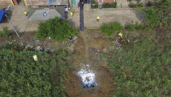 Власти Салвадора су почеле са ископавањем тајног гробља иза куће бившег детектива - Sputnik Србија