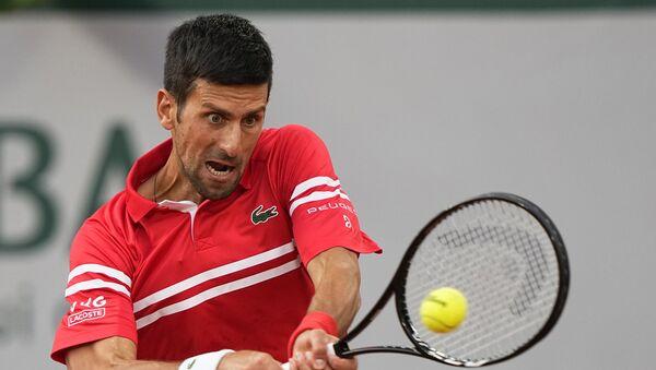 Novak Đoković tokom meča sa Mateom Beretinijem u četvrtfinalu Rolan Garosa - Sputnik Srbija
