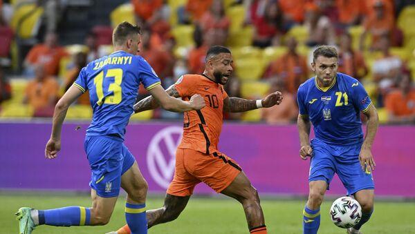 Мемфис Депај – детаљ са утакмице Холандија – Украјина - Sputnik Србија