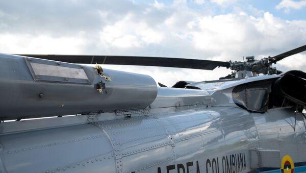 Tragovi pogodaka iz vatrenog oružja na helikopteru kolumbijskog predsednika - Sputnik Srbija