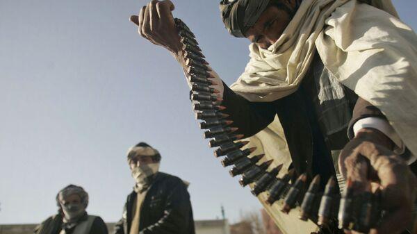 Бывший боец Талибана с патронами в руках - Sputnik Србија