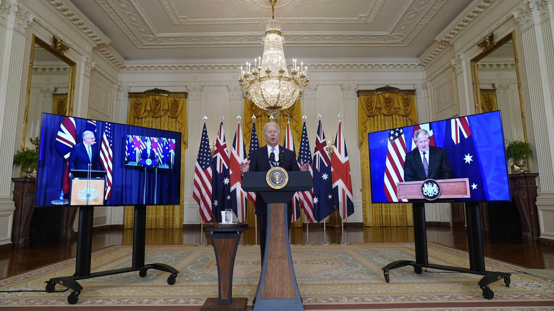 Predsednik SAD Džo Bajden, premijer Australije Skot Morison i premijer Velike Britanije Boris Džonson na sastanku povodom novog saveza AUKUS - Sputnik Srbija, 1920, 30.09.2021