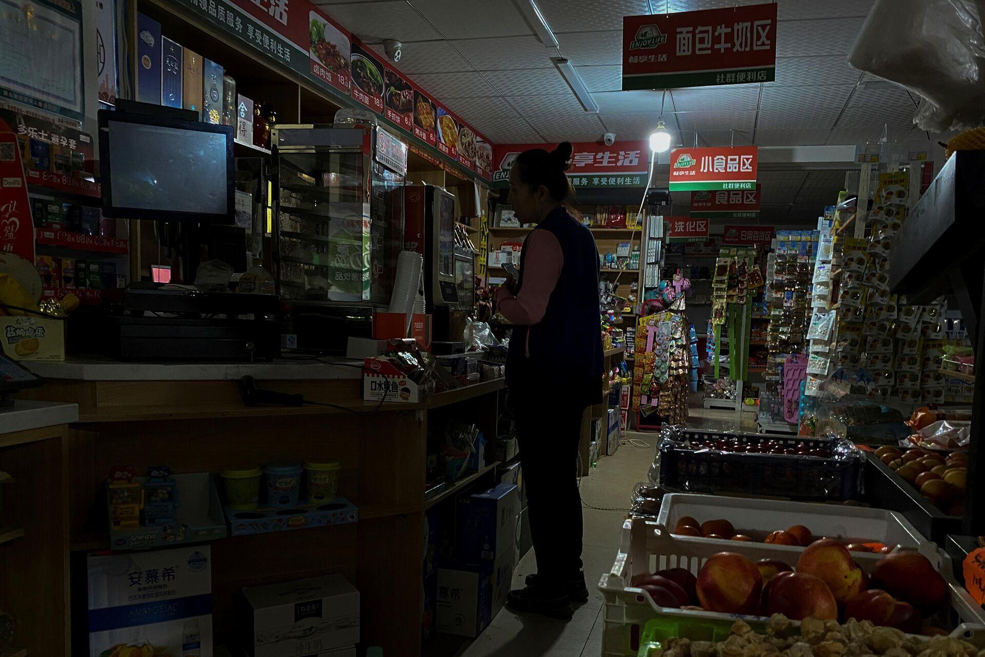Продавница у Кини скоро у мраку због рестрикција струје - Sputnik Србија, 1920, 02.10.2021