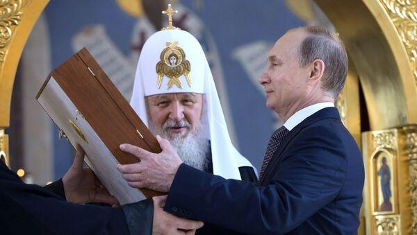 Patrijarh moskovski i sve Rusije Kiril i predsednik Rusije Vladimir Putin - Sputnik Srbija