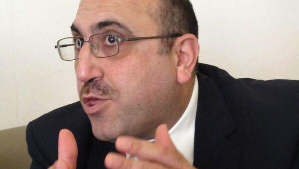 Rami Abdulrahman direktor Sirijske opservatorije za ljudska prava - Sputnik Srbija