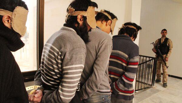 Borci Islamske države u pritvoru sirijske specijalne službe - Sputnik Srbija