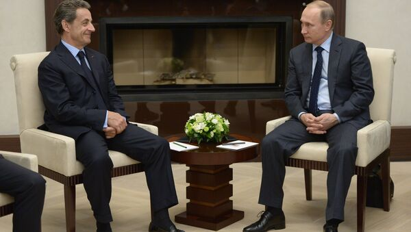 Predsednik Rusije Vladimir Putin i bivši predsednik Francuske Nikola Sarkozi - Sputnik Srbija