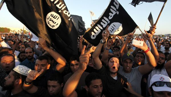 In this Sept. 21, 2012 file photo, Libyan followers of Ansar al-Shariah Brigades and other Islamic militias, hold a demonstration against a film and a cartoon denigrating the Prophet Muhammad in Benghazi, Libya - Sputnik Srbija