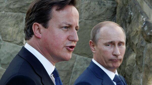 Председник Русије Владими Путин и британски премијер Дејвид Камерон - Sputnik Србија