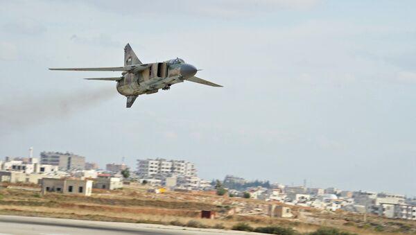 МИГ-23, авион сиријске авијације на аеродрому Хама у близини града Хаме - Sputnik Србија