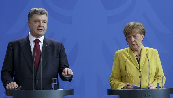 Ukrajinski predsednik Petro Porošenko i nemačka kancelarka Angela Merkel - Sputnik Srbija