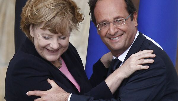 Predsednik Francuske Fransoa Oland i kanclerka Nemačke Angela Merkel - Sputnik Srbija