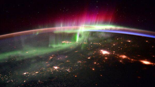 Поларна светлост забележена са Међународне свемирске станице - Sputnik Србија