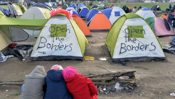 Migranti u izbeglickom kampu u Idomeniju - Sputnik Srbija