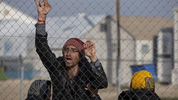 Avganistanski migranti na severnoj grčkoj granici u mestu Idomeni, utorak, 23. februara, 2016 - Sputnik Srbija
