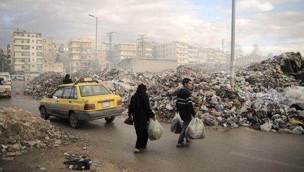 Ljudi na ulicama Alepa u Siriji - Sputnik Srbija
