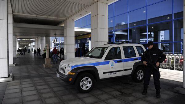 Полиција близу на аеродрому Близу Атине, Грчка 22.03. 2016. године - Sputnik Србија