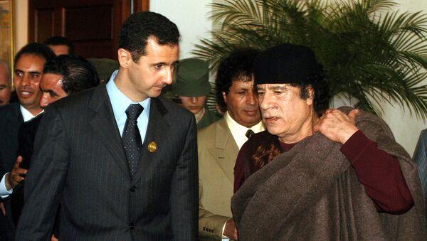 Башар ел Асад и Муамер Гадафи - Sputnik Србија