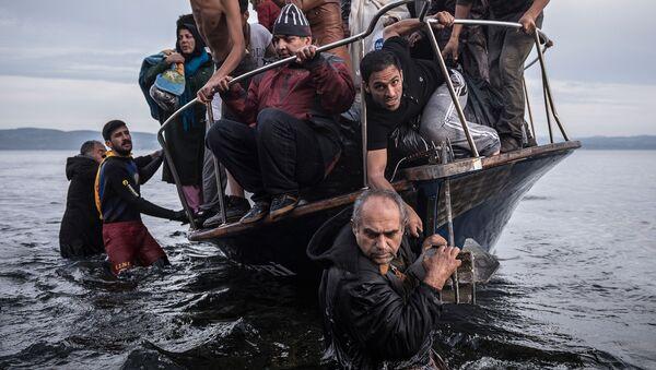 Izbeglice iz Sirije pristižu na grčko ostrvo Lezbos - Sputnik Srbija