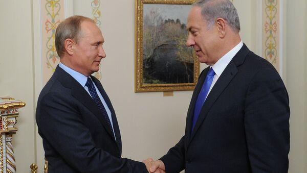 Руски председник Владимир Путин и премијер Израела Бенјамин Нетанјаху - Sputnik Србија