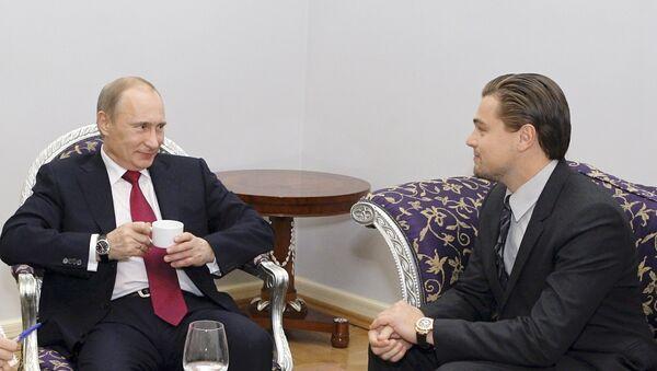Vladimir Putin i Leonardo Di Kaprio u Sankt Peterburgu - Sputnik Srbija