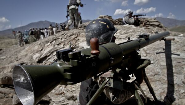 Авганистански гранични полицајац на граници Авганистана и Пакистана - Sputnik Србија