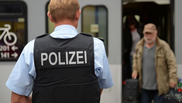 Полицајац на железничкој станици у Минхену, у Немачкој - Sputnik Србија