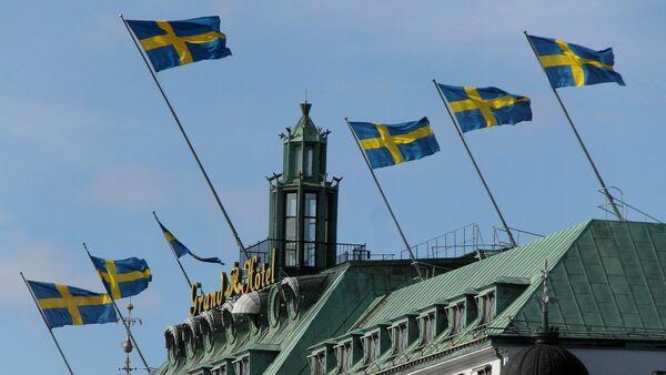 Švedske zastave iznad Grand hotela u Stokholmu, Švedska - Sputnik Srbija