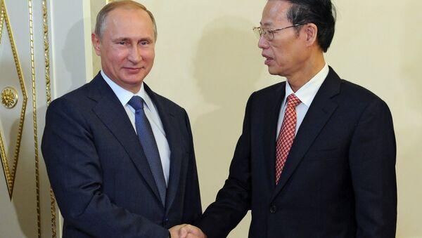 Руски председник Владимир Путин и вицепремијер Кине Џанг Гаоли - Sputnik Србија