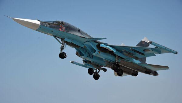 Mnogofunkcionalьnый istrebitelь-bombardirovщik VKS RF Su-34 na aviabaze Hmeйmim v Sirii - Sputnik Srbija
