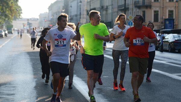 Портпарол Кремља Дмитриј Песков током трке у оквиру 20. Петербуршког међународног економског форума - Sputnik Србија