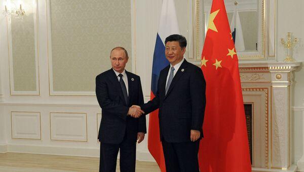 Predsednik Rusije Vladimir Putin i predsednik Kine Si Đinping - Sputnik Srbija