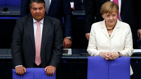 Зигмар Габријел и Ангела Меркел - Sputnik Србија