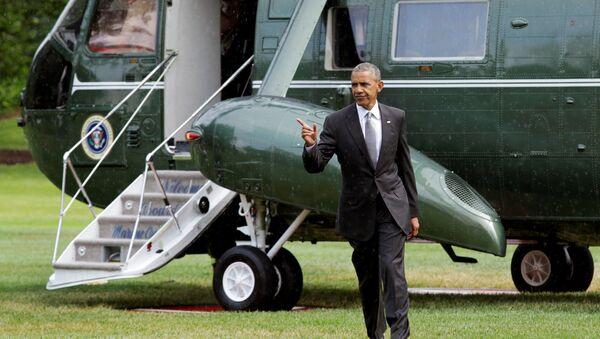 Američki predsednik Barak Obama na Južnom travnjaku ispred Bele kuće - Sputnik Srbija