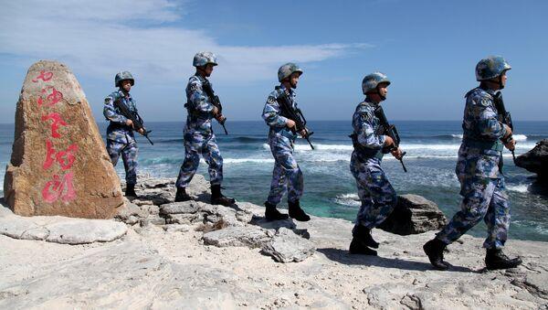 Vojnici Narodnooslobodilačke vojske Kine patroliraju ostrvom u Paracelskom arhipelagu - Sputnik Srbija