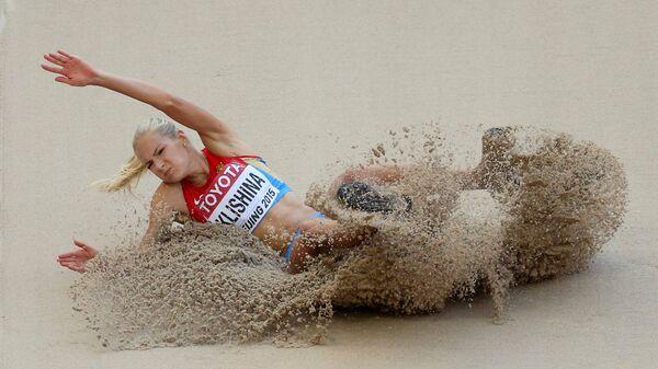Ruska atletičarka Darja Klišina tokom takmičenja u skoku u dalj na Svetskom prvenstvu u Pekingu. - Sputnik Srbija
