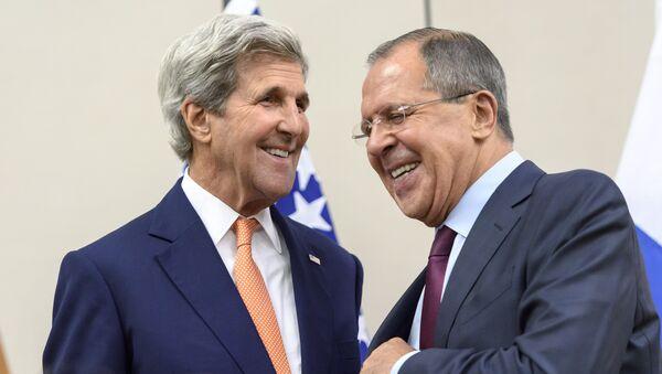 Američki državni sekretar Džon Keri i ministar spoljnih poslova Rusije Sergej Lavrov nakon sastanka u Ženevi. - Sputnik Srbija