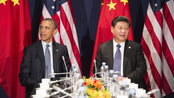 Predsednik SAD Barak Obama i predsednik Kine Si Đinping - Sputnik Srbija