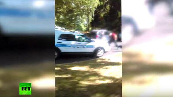 Полицијски аутомобил на месту убиства Кита Скота у Шарлоту - Sputnik Србија
