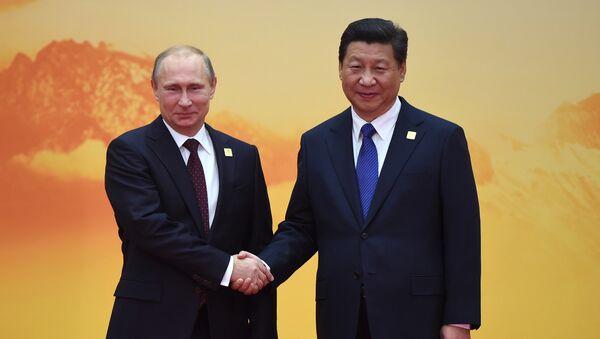 Председник Русије Владимир Путин и председник Кине Си Ђинпинг на састанку Азијско-пацифичке економске сарадње - Sputnik Србија